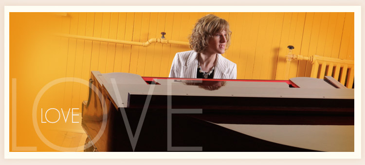 Photograph of Becka deHaan sitting at a piano