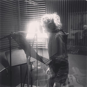 Becka deHaan standing in a vocal booth